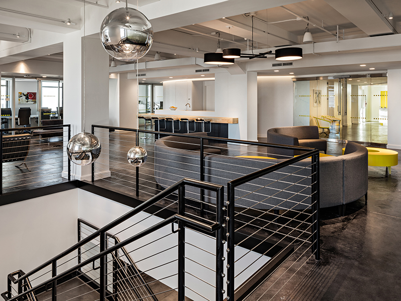 Spector Group's design for Magna, a New York City investment firm headquartered at 40 Wall St. in Manhattan, illustrates the Millennial influence on the corporate settings of tenants in traditional business categories. Copyright (c) 2015 Ben Gancsos.