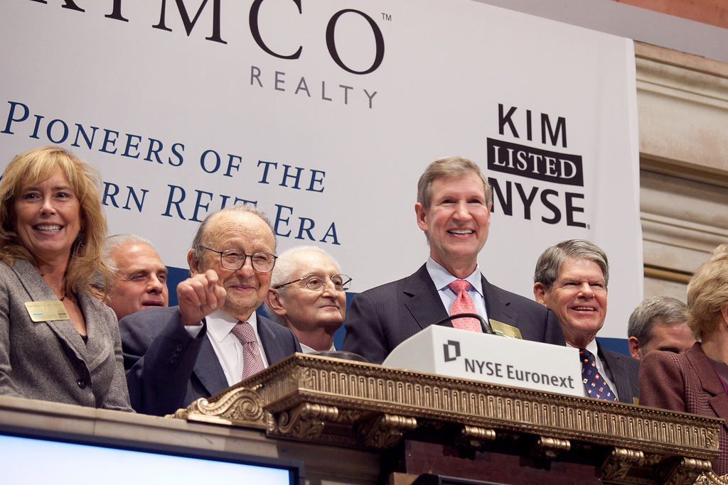 Barbara Pooley, Richard Wohlmacher, Milton Cooper, Frank Lourenso, Dave Henry and Joe Grills of Kimco Realty Corp. ring the NYSE closing bell in 2011 to celebrate 20 years since its 1991 IPO. (Credit: Kimco Realty Corp.)