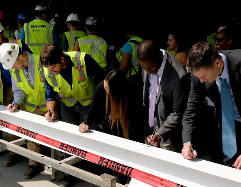 The DC team signs final beam at topping out of 99M St. in Washington, D.C.