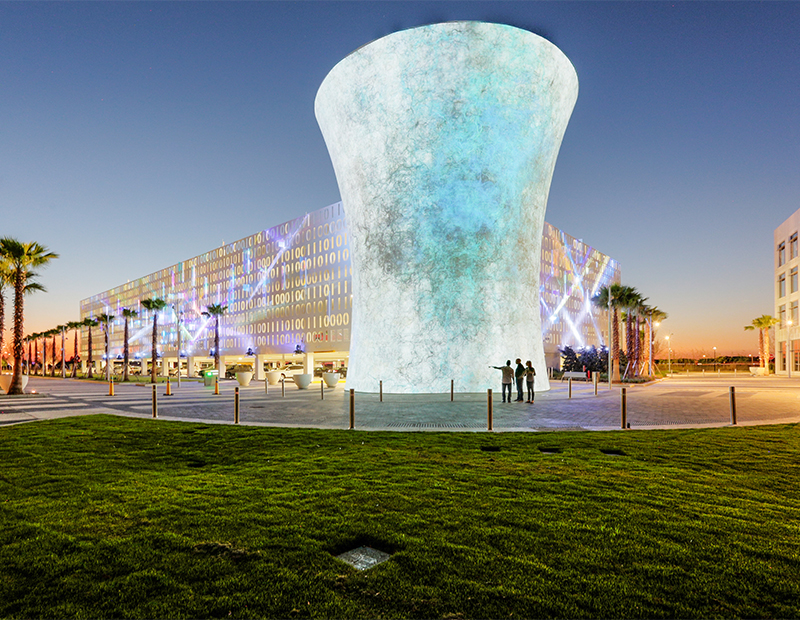 In a characteristic New Urbanism strategy, the Beacon and Code Wall at Lake Nona Town Center in Orlando disguise a parking garage. Lake Nona draws on New Urbanism strategies throughout its 17-square-mile footprint.