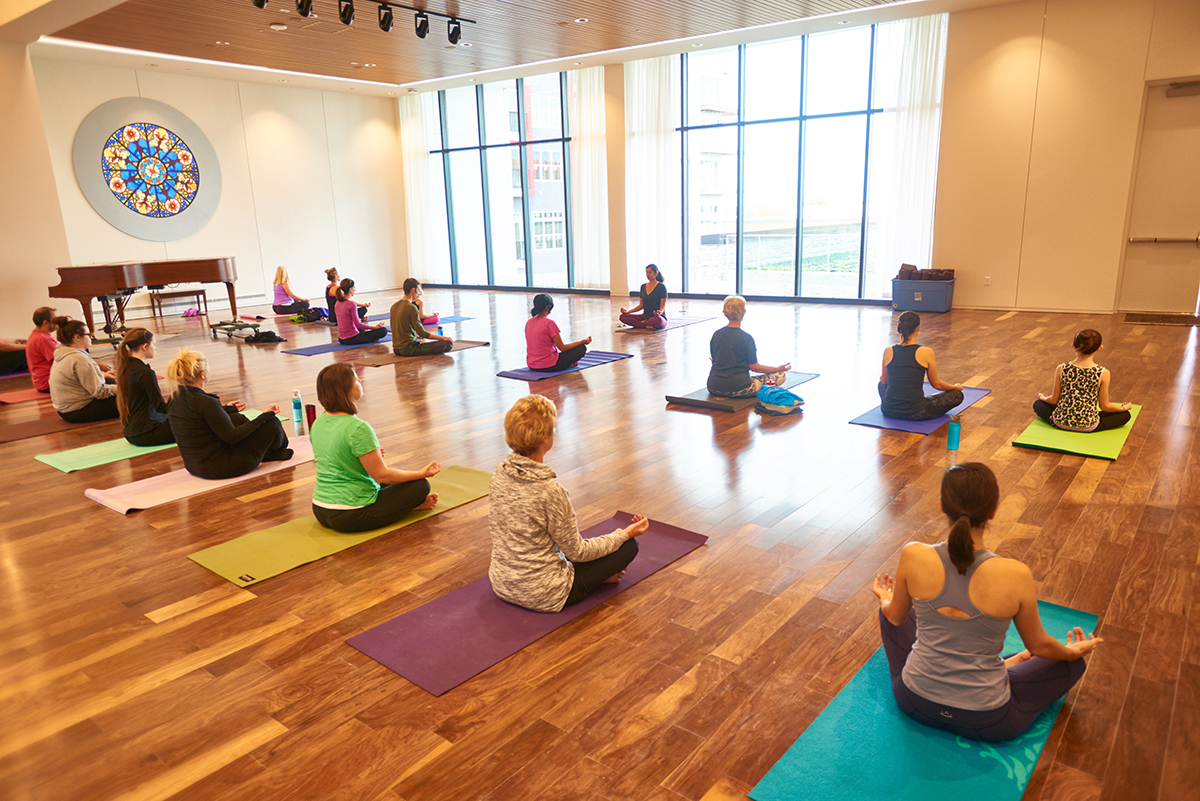 Yoga studios are a trending offering in retail spaces, as owners are looking for ways to keep customers inside their shopping centers for longer. Image courtesy of Todd Joyce.