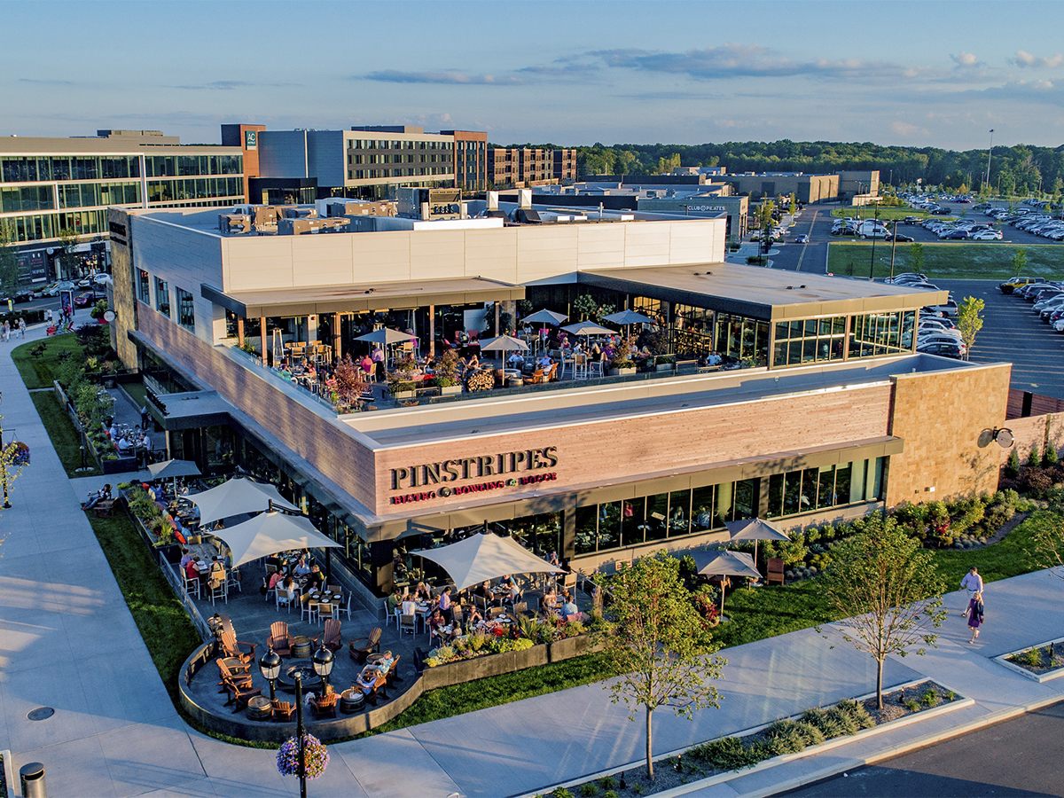 Pinstripes' location at one of the newest retail venues in Ohio offers food and entertainment under the same roof. Clients can try bowling before or after a meal. Image courtesy of Pinecrest.