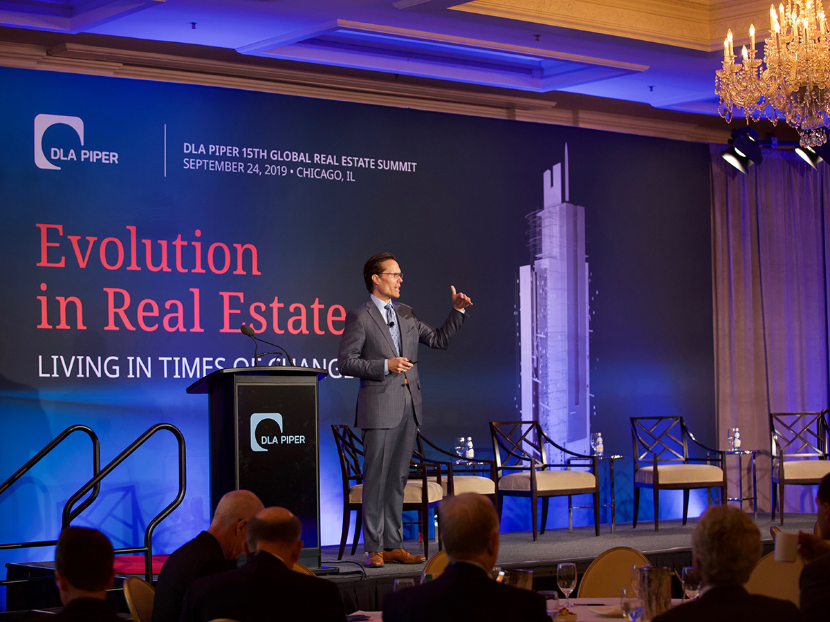 Steve Weikal speaking at DLA Piper's 15th Global Real Estate Summit. Image courtesy of Michelle Weeks.