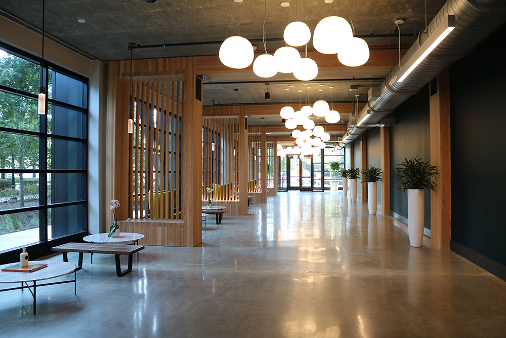 Developed by Hines and designed by Hartshorne Plunkard Architecture (HPA) and DLR Group, T3 West Midtown in Atlanta is a seven-story, heavy-timber office building spanning more than 230,000 square feet, including a shared social workspace on the ground floor. Image courtesy of Hines