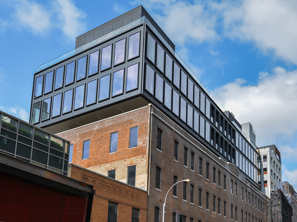 Designed by Morris Admi Architects, The Warehouse features a modern, three-story glass expansion atop a four-story brick base comprising a former industrial building in Manhattan's Chelsea district. Elijah Equities developed the new Class A office property at 520 W. 20th St. Image courtesy of Noel Calingasan